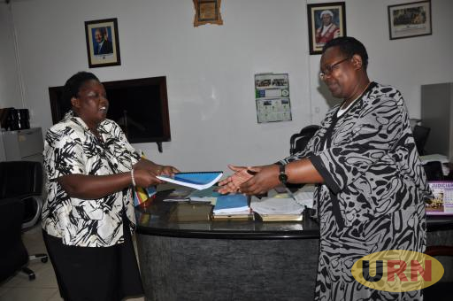 Caption: Dorcas Okalany (L) hands over office to Dr Nassali Lukwago (R) last week. However, the latest development is that the recent transfer of all the permanent secretaries have been rescinded.